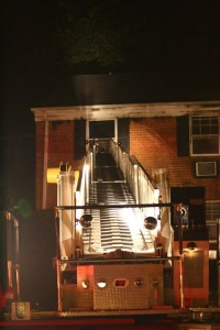 Ladder-up-to-3rd-floor-fire-room.-2nd-alarm-fire-on-Westover-Ave.-Photo-by-Drew-Abel-200x300